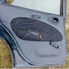Обшивка(карта) двери задняя левая Ford Escort
